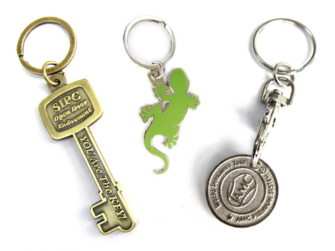 die struck brass, hard enamel keyrings and photo etched trolley coin keyring