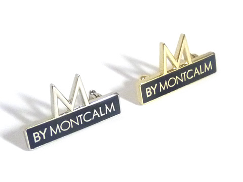 Montcalm hotel branded enamel badges with silver and gold plated metal