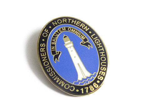 Bespoke enamel pin badges made for Northern Lighthouses.