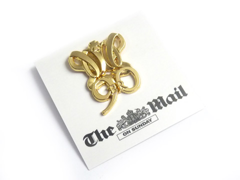 Custom Gold plated Queens lapel badges on branded printed backing card