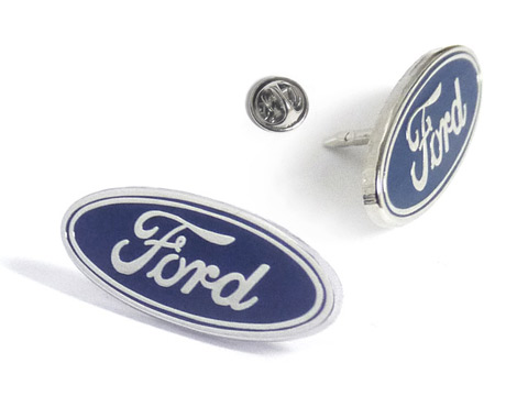 Ford enamel badges photographed from different angles