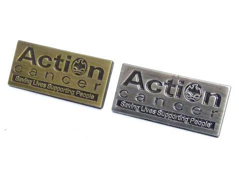 Action Cancer charity badges.